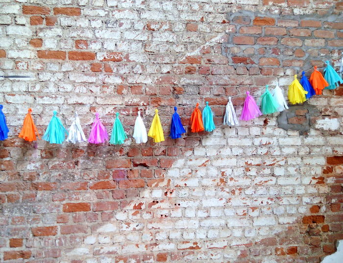 Backgrounds Brick Wall Colorful Colorful Background Diy Project Diy Tassels Multi Colored No People Old Stone Wall Tassel Decoration Tassel String Tassels Urban Wall Urbanphotography Wall Wall - Building Feature Wall Decoration