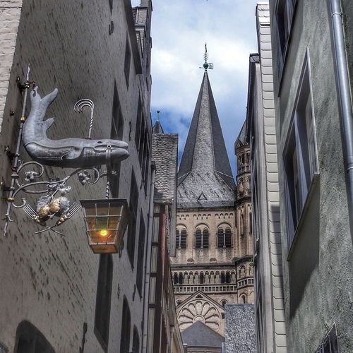 Upward alley view with Lantern and Church Tower in Cologne, Germany Lantern Church Building Exterior Architecture Built Structure Building Place Of Worship Religion Spirituality Low Angle View Sky No People City Tower