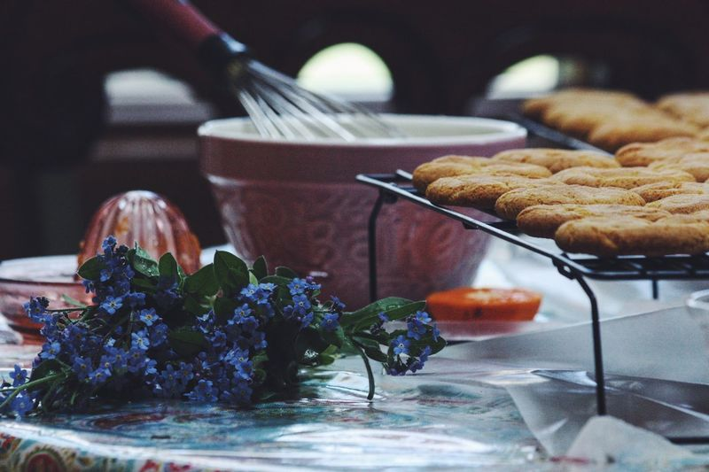 Close-Up Of Cookies With Flower On Table
