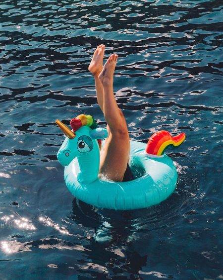 Done That. The Week On EyeEm Unicorn Floating On Water Inflatable  Colorful Color Explosion Water Sea Legs Female Swimming Pool Legs out of a unicorn inflatable caught at the right moment of her dive. Done That. Visual Creativity