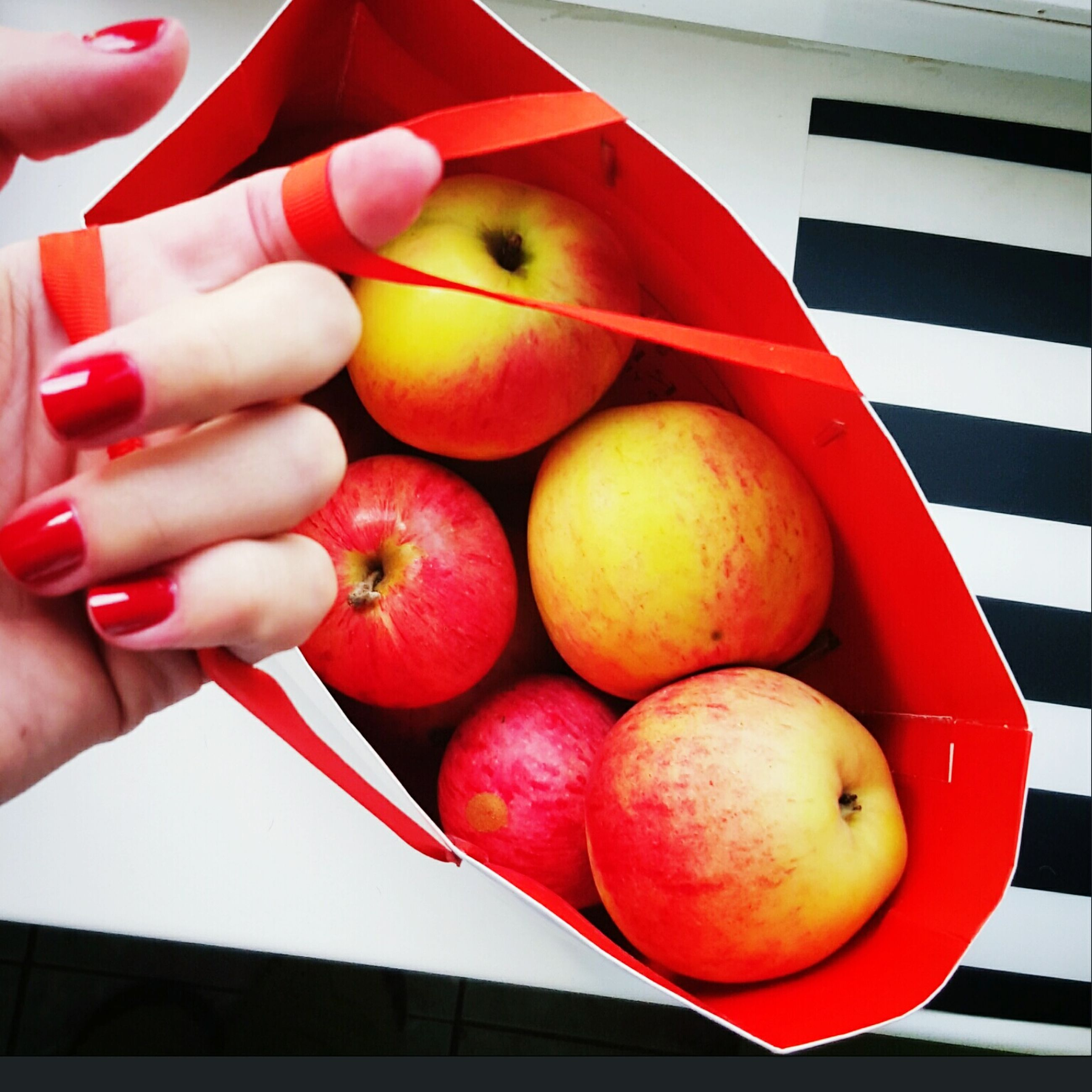 food and drink, food, person, holding, fruit, healthy eating, freshness, cropped, part of, lifestyles, red, unrecognizable person, indoors, human finger, leisure activity, apple - fruit, vegetable
