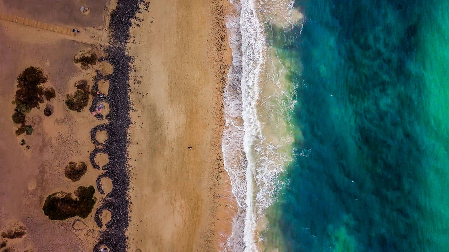 Photos taken at Fuerteventura at Cannary Islands mostly from drone at the beaches during sunrises and sunsets. Fuerteventura SPAIN Canary Islands Island Island Life Vacations Drone  Dronephotography Ocean Ocean View Sea Wave Artistic Exotic Rocks Epic Coastline Shore Beach Land Motion Outdoors Beauty In Nature Water Nature Holiday Moments A New Perspective On Life