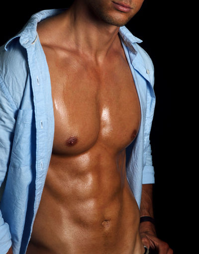 Abdomen Athlete Black Background Close-up Exercising Handsome Healthy Lifestyle Human Body Part Human Hand Lifestyles Macho Masculinity Men Midsection Muscular Build One Man Only One Person Real People Shirtless Sport Standing Strength Studio Shot Torso Young Adult