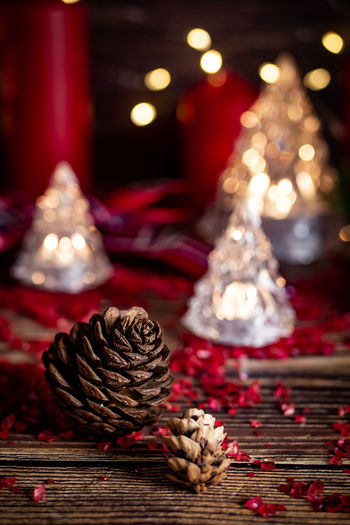 Holiday Celebration Christmas Christmas Decoration Decoration Table Red Christmas Ornament Indoors  christmas tree Illuminated Pine Cone Tree Holiday - Event Food And Drink Still Life Wood - Material No People Advent