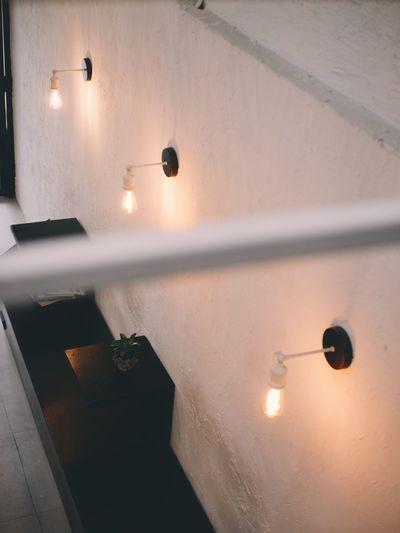 High angle view of illuminated light bulbs on wall