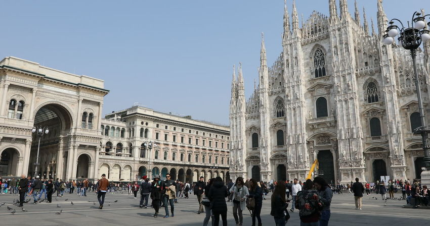 MILAN, ITALY- MARCH 7, 2017: Tourists walking and taking pictures with pigeons in Piazza Duomo of Milano fashion city. Ground view of this historic Gothic cathedral. tourists walking for shopping inside the Galleria Vittorio Emanuele II gallery in Piazza Duomo square. Famous fashion stores like Prada. Luxury and shopping concept. Cathedral Church City Duomo DuomoDiMilano Fashion Italia Milan Milan Italy Milan,Italy Milano Milano Italy Square Vittorio Emanuele II Vittorio Emanuele II Gallery Adult Arch Architecture Building Exterior Built Structure City Crowd Dome Duomo Di Milano Duomo Square Galley Group Of People History Italy Italy❤️ Large Group Of People Lifestyles Men Milanocity Nature Outdoors Real People Sky Statigram The Past Tourism Travel Travel Destinations Women