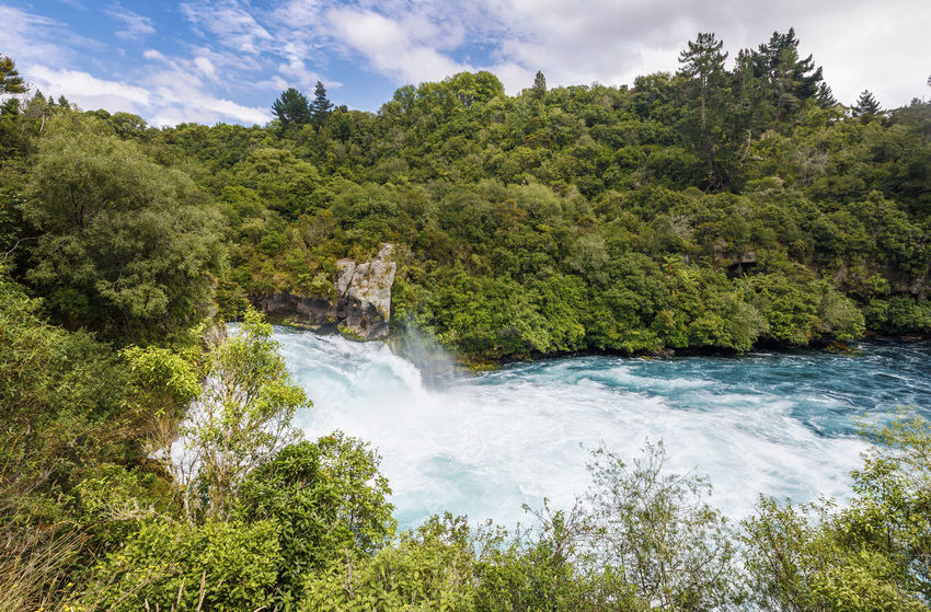 Panoramic view of Huka Falls, New Zealand New Zealand Scenery Beauty In Nature Cloud - Sky Day Environment Flowing Flowing Water Forest Green Color Growth Huka Falls Land Motion Nature New Zealand No People Outdoors Plant Power In Nature River Scenics - Nature Sky Tree Water Waterfall