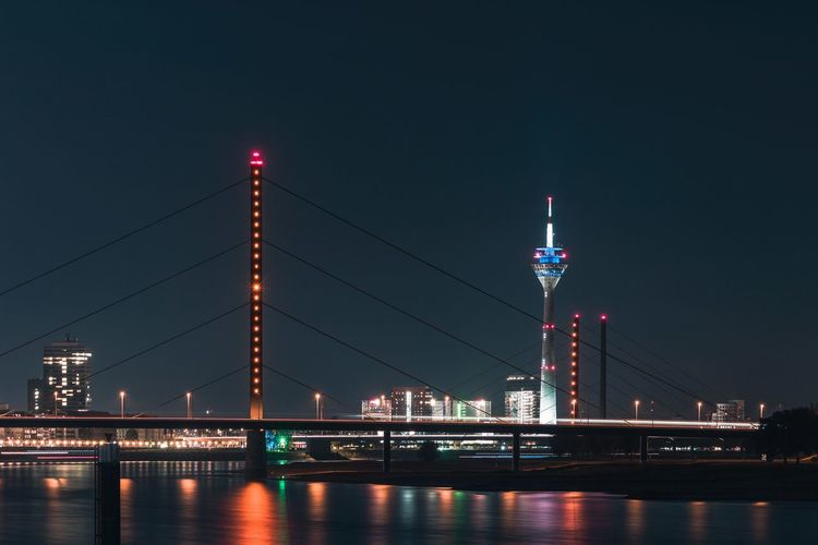 Architecture Built Structure Night Illuminated Connection Bridge Sky Building Exterior City River Bridge - Man Made Structure Engineering Water Travel Destinations Transportation Waterfront Tower Tall - High Office Building Exterior Skyscraper Outdoors Modern Cityscape Düsseldorf Skyline