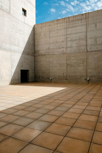 Museum Of Memory Granada Granada, Spain Minimal Minimalist Architecture Architecture Built Structure Building Exterior Wall - Building Feature Sky Sunlight Flooring Building No People Day Cloud - Sky City Shadow Nature Pattern Outdoors Modern Tile Tiled Floor Wall Paving Stone Concrete