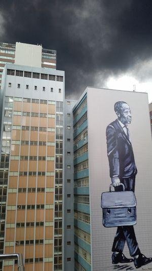EyeEm Diversity Skyscraper Culture City ArtWork Mural Fleeing The Danger Fleeing The City Smoke