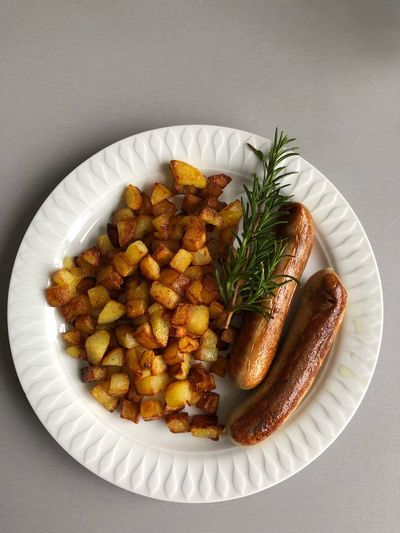 Vegan fried potatoes and sausages / Bratkartoffeln und veganes Würstchen Fried Potatoes Potatoes Bratkartoffeln Vegan EyeEm Selects Plate Prepared Potato Food And Drink Food Ready-to-eat Studio Shot Healthy Eating No People Indoors  Close-up