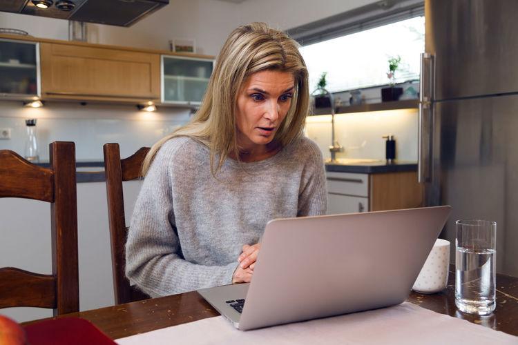 Portrait of woman using laptop