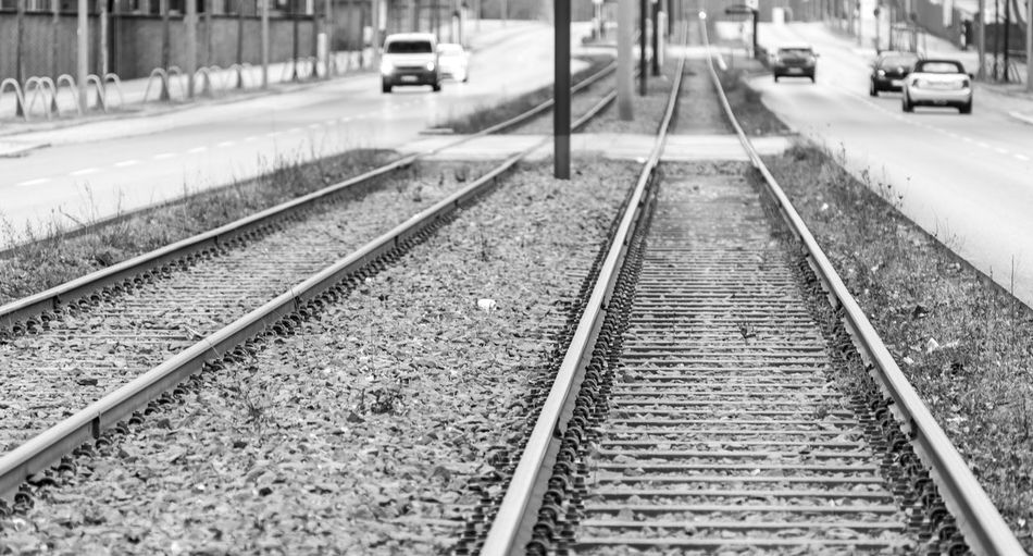 Black And White City Focus On Foreground Tramway Tram Ways Railway Track Rails Traffic Transportation Railroad Track Track Mode Of Transportation Rail Transportation Direction The Way Forward Diminishing Perspective Motor Vehicle Land Vehicle Car No People Public Transportation vanishing point Day Travel Street Selective Focus Road