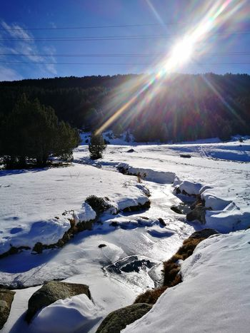 Snow Sunlight Lens Flare Cold Temperature Winter Nature Landscape Beauty In Nature No People Outdoors Tranquility Frozen Frozen River Andorra🇦🇩 Perspectives On Nature