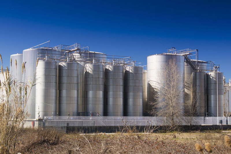 Silo Sky Nature Plant Day Storage Tank Factory Industry Building Exterior Built Structure Agriculture Clear Sky Storage Compartment No People Land Field Sunlight Outdoors Blue Architecture Fuel Storage Tank Chemical Plant
