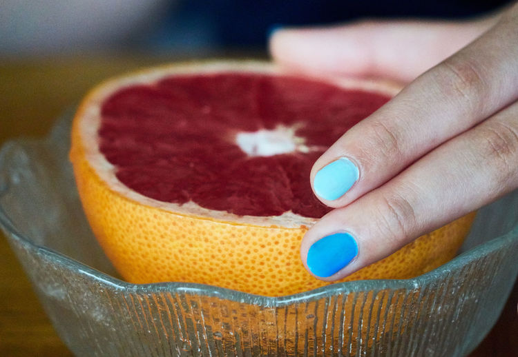 Body Part Close Up Close-up Colorful Finger Fingernail Fingers Focus On Foreground Food Food And Drink Freshness Fruit Grapefuit Hand Healthy Eating Holding Human Body Part Human Finger Human Hand Indoors  Leisure Activity Lifestyles Nail One Person Orange Real People