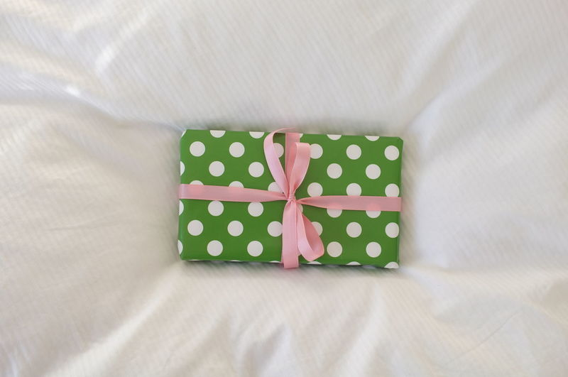 Indoors  Pattern Textile No People Surprise Polka Dot Bow Tied Bow Still Life Green Color Spotted Close-up Ribbon - Sewing Item Ribbon High Angle View Tied Up Furniture Emotion Gift Linen Present Birthday