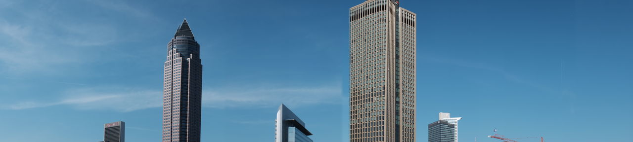 High section of skyscrapers against blue sky