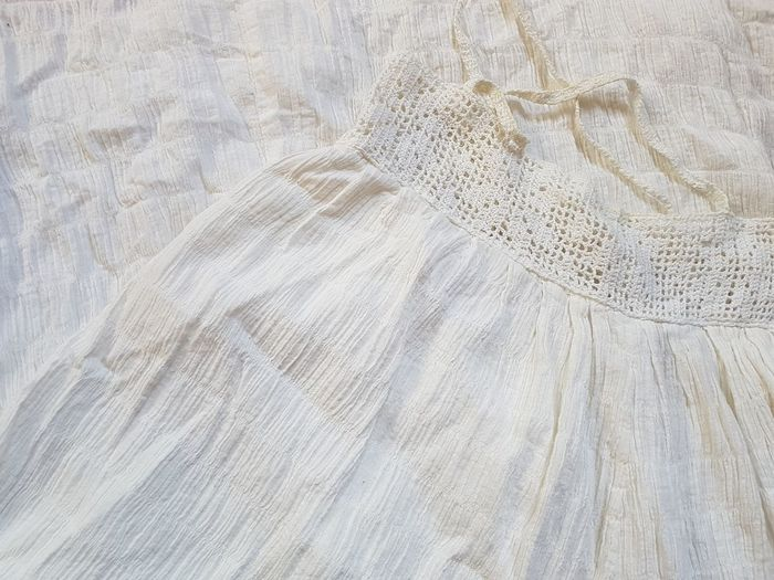 High angle view of white cloth on bed
