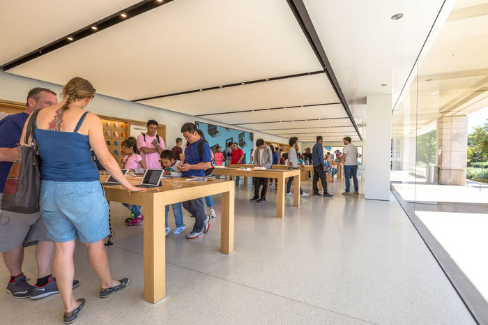 Cupertino, California, United States - August 15, 2016: the Apple world headquarters at One Infinite Loop. Apple is a multinational that produces consumer electronics, personal computers and software. people come from the popular Apple store of Apple Inc Headquarters at One Infinite Loop located in Cupertino, Silicon Valley, California. Apple California IT Mac PC United States Architecture Building Computer Cupertino Day Electronics Industry Flag Full Length Headquarter Headquarters Hq IMac27 IPhone Imac Indoors  Infinite Loop Large Group Of People Leisure Activity Lifestyles Men Mobile People Real People Standing Store Women Young Adult