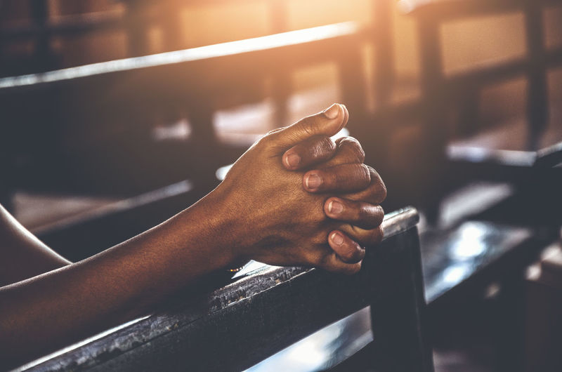 Real People Hand Human Hand One Person Human Body Part Indoors  Focus On Foreground Sunlight Lifestyles Men Close-up Body Part Finger Human Finger Day Unrecognizable Person Leisure Activity Holding Hope Praying Pray Belief Trust Religion Worship