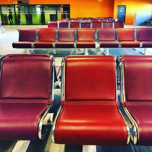Empty chairs in row