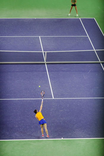 High Angle View Of Women Playing Tennis On Court