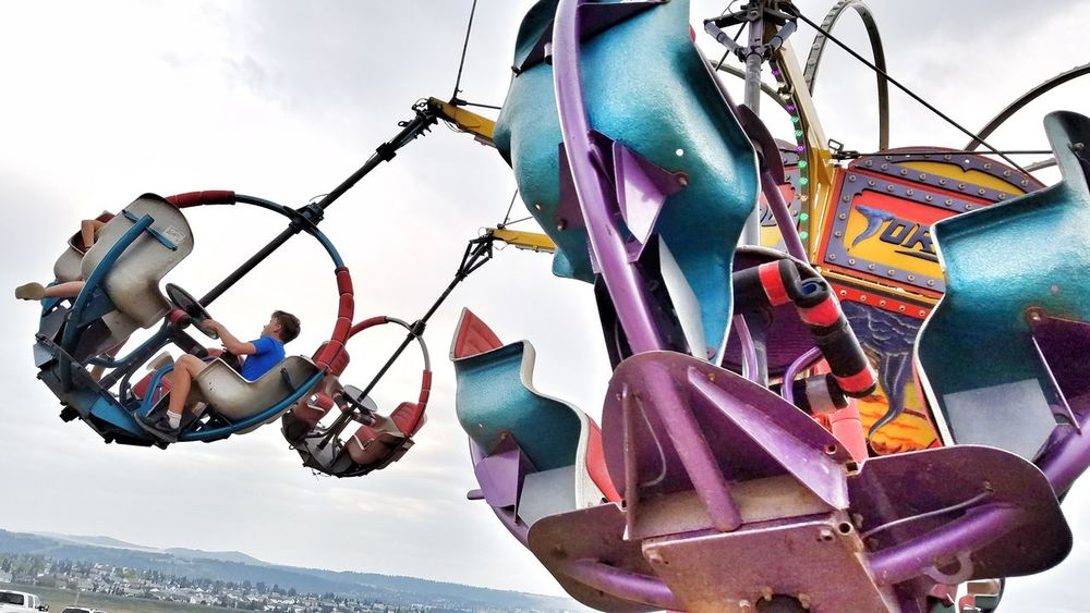 Day Hanging Outdoors Amusement Park Sky Low Angle View Multi Colored Rides Rides At Fair