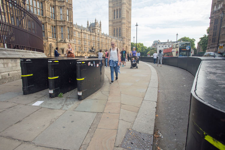 Anti Terrorism Barriers Lorry Sidewalk Tourists Accessories Architecture Built Structure Car Day Outdoors Pavement People Prevent Protection Sky Terror Vehicle