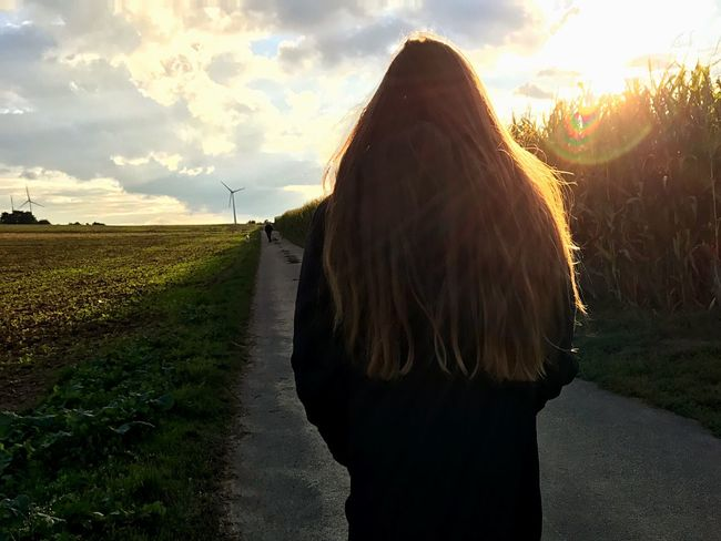 Autumn Rear View One Person Real People Sky Field Cloud - Sky Sunset Rural Scene Landscape Outdoors Nature Women Long Hair