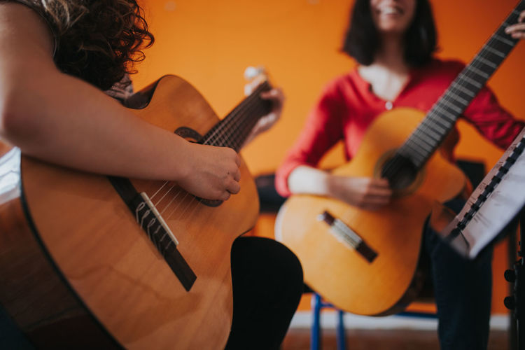Guitar Lessons Learning Music Skill  Teaching Adult Arts Culture And Entertainment Concentration Guitar Guitar Love Guitar Player Guitarist Guitars Music music brings us together Music Is My Life Music School Musical Equipment Musical Instrument Musical Instrument String Musician Musicians Playing String Instrument Women