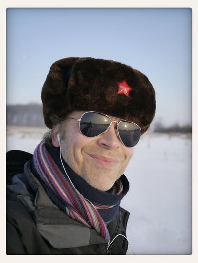 Portrait of Smiling Mid Adult Man On Snowy Field Against Clear Sky