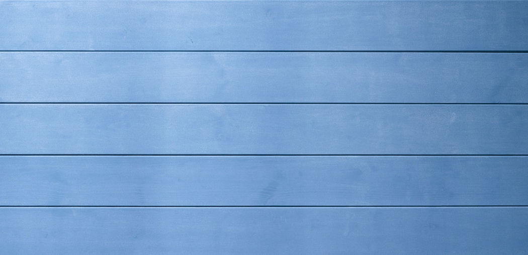 Low angle view of blue wall