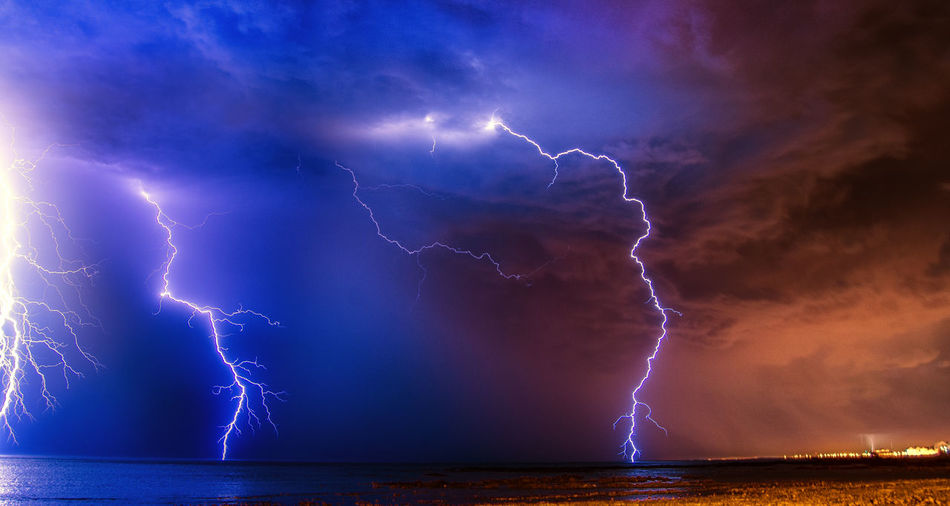 Lightning in sky over sea