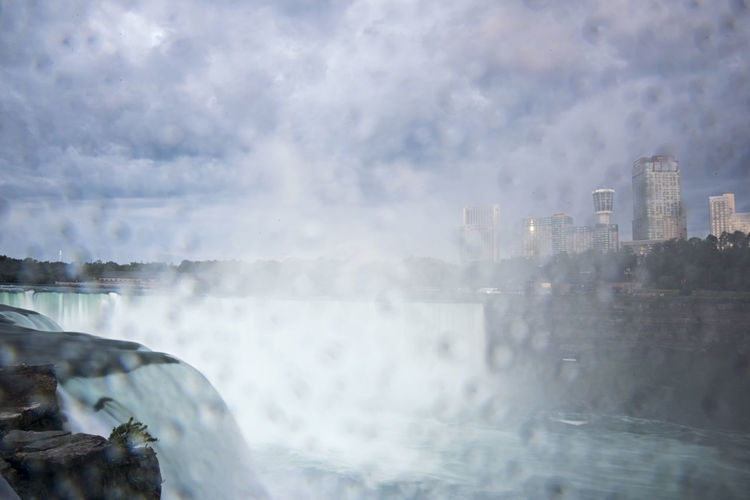 Raindrops—well, drops of mist—obscure a view of the Horseshoe Falls in Niagara Falls, NY. City Day Distortion Landscape M Mist On Lens Nature Niagara Falls Canada Niagara Falls NY Niagra Falls No People Outdoors Raindrops River Sky Skyline Splashing Spraying State Park  Umbrella United States Water Waterfall Waterfront Weather