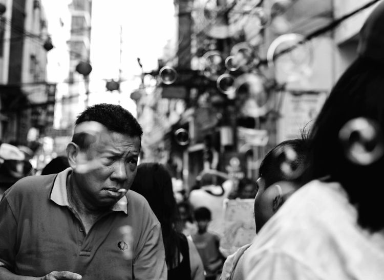 Walk with bubbles. Bnw_greatshots Bnw Bnwphilippines Streetsofmanila Bnwmood Bnwportrait Streetphotography Bnw_of_our_world Wheninmanila Luneta Bnwphotography Igers Street Manila Philippines Nikond3300 Igersmanila Igersbnw Nikon 35mm Non-profit Organization Altruism Community Outreach Sapling Charitable Donation Garbage Bag Social Services Social Responsibility Vanguardians Volunteer City Street Charity And Relief Work Dating Stories From The City EyeEmNewHere Visual Creativity Focus On The Story The Street Photographer - 2018 EyeEm Awards The Portraitist - 2018 EyeEm Awards The Still Life Photographer - 2018 EyeEm Awards The Traveler - 2018 EyeEm Awards The Photojournalist - 2018 EyeEm Awards