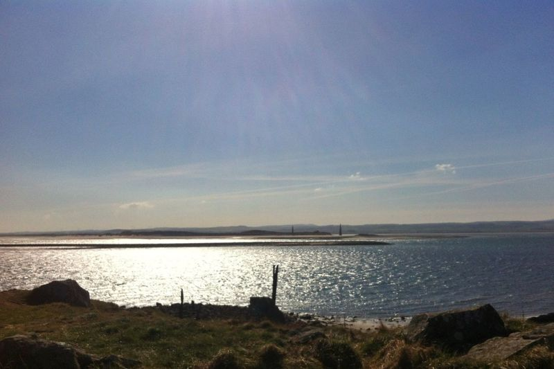An unexpected, iPhone-only, midday-sun-drenched trip to Holy Island.