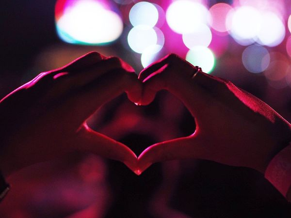 Girl making a heart-shape symbol in concert. Adult Bokeh Close-up Concert Focus On Foreground Heart Heart Shape Holding Human Body Part Human Finger Human Hand Illuminated Indoors  Leisure Activity Lifestyles Love Night One Person People Real People Shape Shape Of Heart
