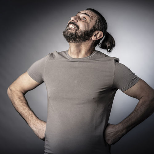 Man Portrait Casual Adult Cheerful Standing Joy Happy Smile Looking Confident  Positive Caucasian Happiness White Studio Expression Handsome Gesturing Shirt Confidence  Success Lifestyle Successful Long-hair Beard Bearded 50s Look Up