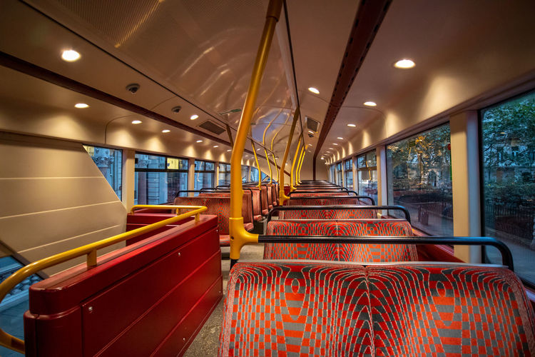 Inside London Bus British Culture Seat Vehicle Interior Indoors  Illuminated In A Row Public Transportation No People Transportation Mode Of Transportation Bus Day Red Rail Transportation