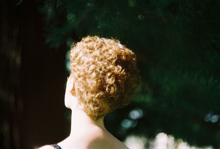 Rear view of woman with short blond hair