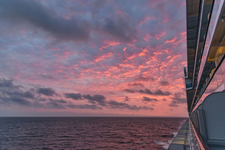 Sky Sea Sunset Cloud - Sky Water Horizon Horizon Over Water Beauty In Nature Scenics - Nature Orange Color Nature No People Tranquil Scene Outdoors Built Structure Ship Boat Cruise Ship Reflection Nightphotography Vacation Time