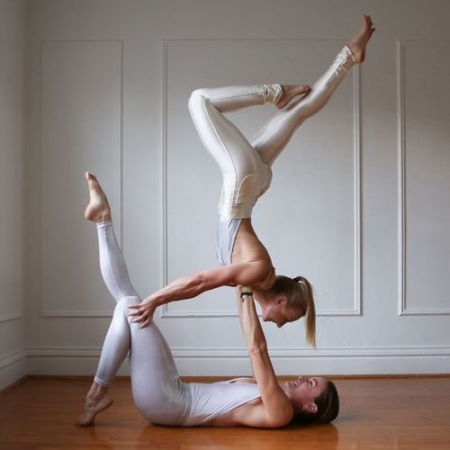 Flexibility Two People Full Length Skill  Togetherness Young Women Performance Grace Stretching Yoga Indoors  Expertise Lifestyles Exercising Blond Hair Ballet Dancer Acrobatics