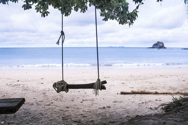 Serene Swing in Koh Lanta, Thailand Ocean View Travel Adventure Beach Beach Swing Beachphotography Beauty In Nature Cloud - Sky Day Horizon Horizon Over Water Land Nature No People Outdoors Sand Scenics - Nature Sea Sky Swing Tranquil Scene Tranquility Tree Water Waves