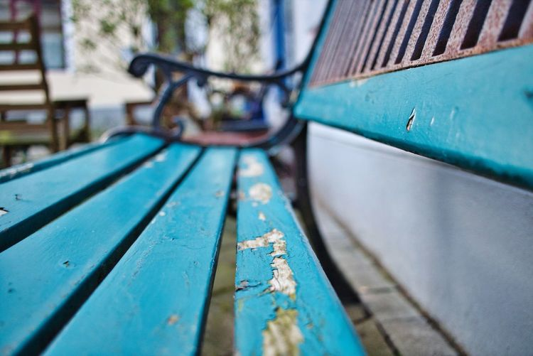 Close-up of old empty bench