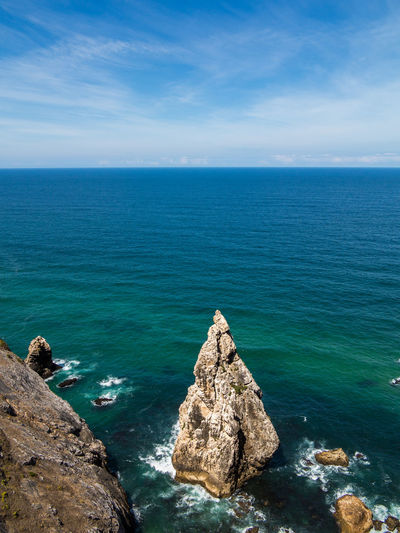 Cabo da Roca - Beautiful coastline of Portugal with Atlantic ocean and beach Sea Water Beauty In Nature Horizon Over Water Horizon Sky Rock Scenics - Nature Rock - Object Solid Tranquility Tranquil Scene Blue Nature Idyllic Day Cloud - Sky Land Rock Formation No People Outdoors Turquoise Colored Rocky Coastline