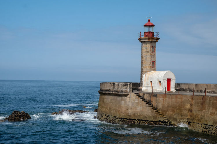 Water Sea Sky Architecture Building Exterior Built Structure Lighthouse Horizon Over Water Tower Nature Horizon Guidance Motion Travel Building Waterfront No People Direction Scenics - Nature Outdoors Breaking Lighthouse Harbour Atlantic Coast