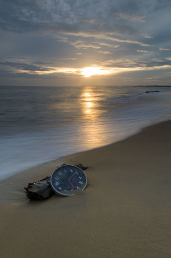 Concept alarm clock on beach of island, malaysia. Wall Clock Fine Art Photography Long Exposure Wallpaper Background Malaysia Color Concept Water Wave Sea Sunset Beach Nautical Vessel Low Tide Sand Shadow Sunlight