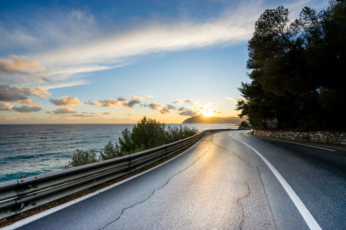Liguria italy road at sunset Forward Path Road Beauty In Nature Day Dusk Nature No People Outdoors Road Scenics Sky Sunset The Way Forward Transportation Tree