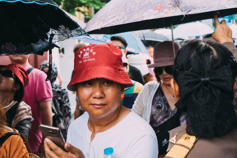 Portrait of people holding smart phone at market